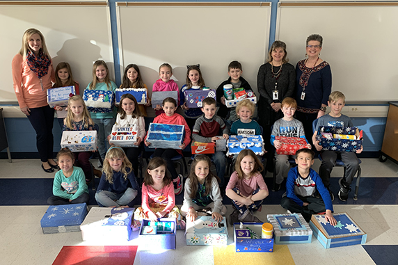 Students prepare Winter Blues Care packages for their teachers