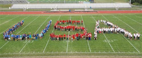 EAMS students dressed in red, white and blue and stood in formation spelling out USA