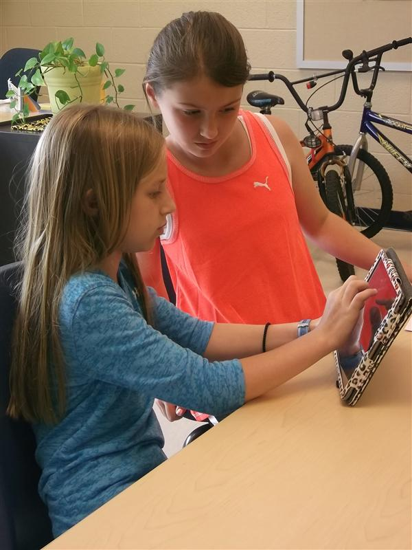 Students work together to create in iMovie